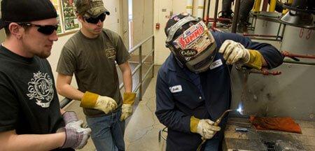 students welding at a welder school